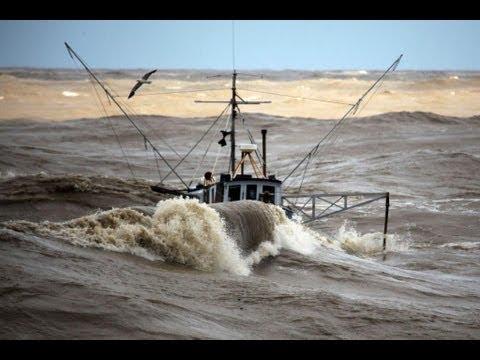 Incredible video —  fishing boats in rough sea